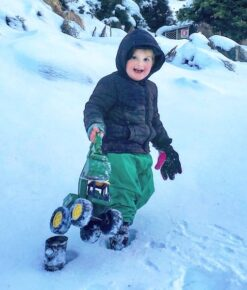 Boy Playing in Snow wearing Green NZ-Made Childrens Waterproof Fleece Lined Overpants