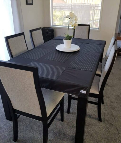 NZ-made custom black elasticated, fitted tablecloth protecting a dining room table