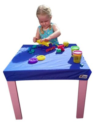 Young child playing playdough at a square table protected with a Mud Mates NZ-made fitted tablecloth
