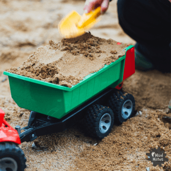 Sandpit play using construction toys
