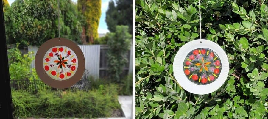 Nature suncatcher crafts for kids - paper plate summer suncatcher hanging in the window and outside