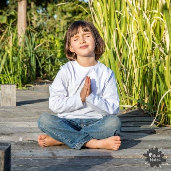 Young child sitting outside doing mindfulness activities